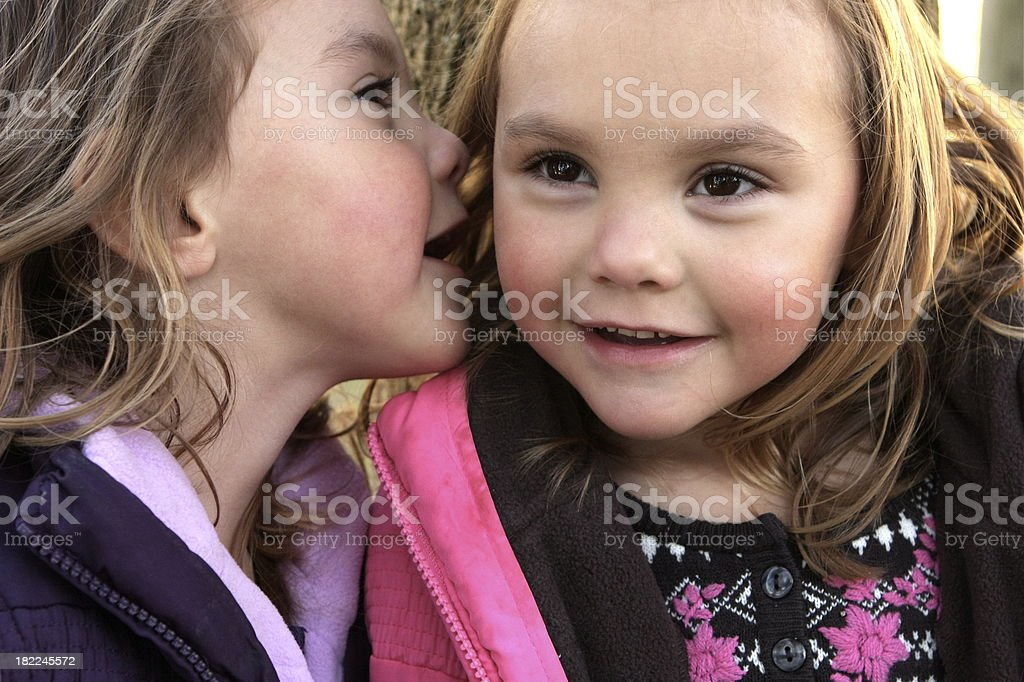 Sisters Sharing Secrets stock photo