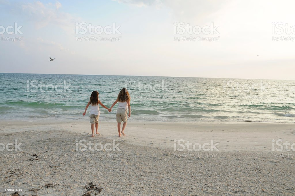 Sisters walking on the beach royalty-free stock photo