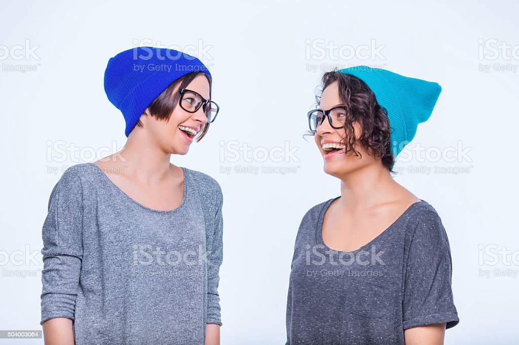 Sisters wearing identical accessories stock photo