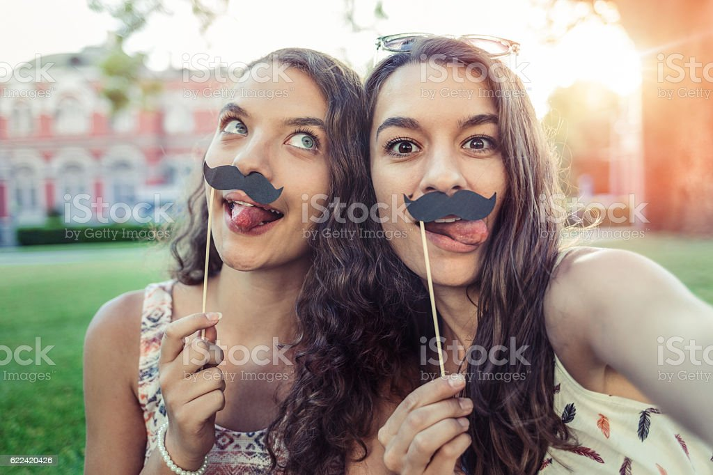 Sisters with mustaches stock photo
