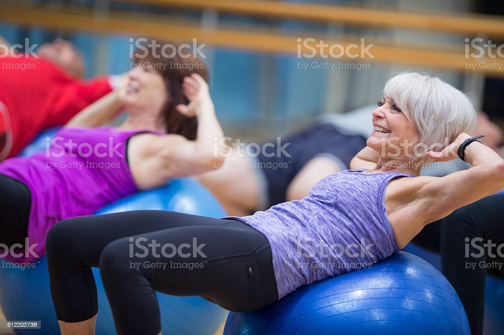 Sit Ups on an Exercise Ball stock photo