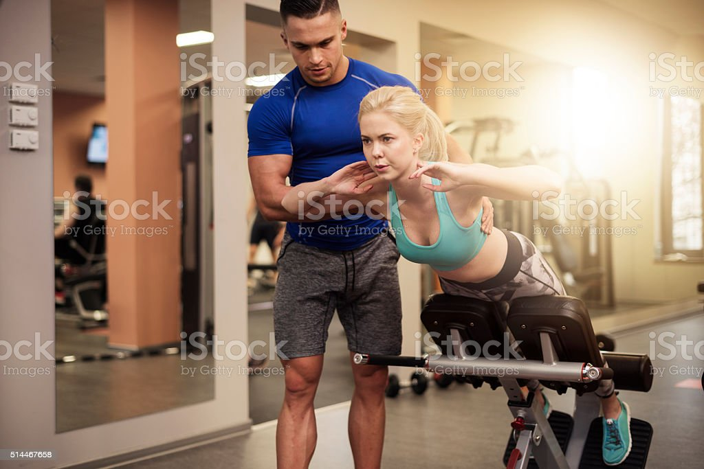 Sit ups on exercise machine stock photo
