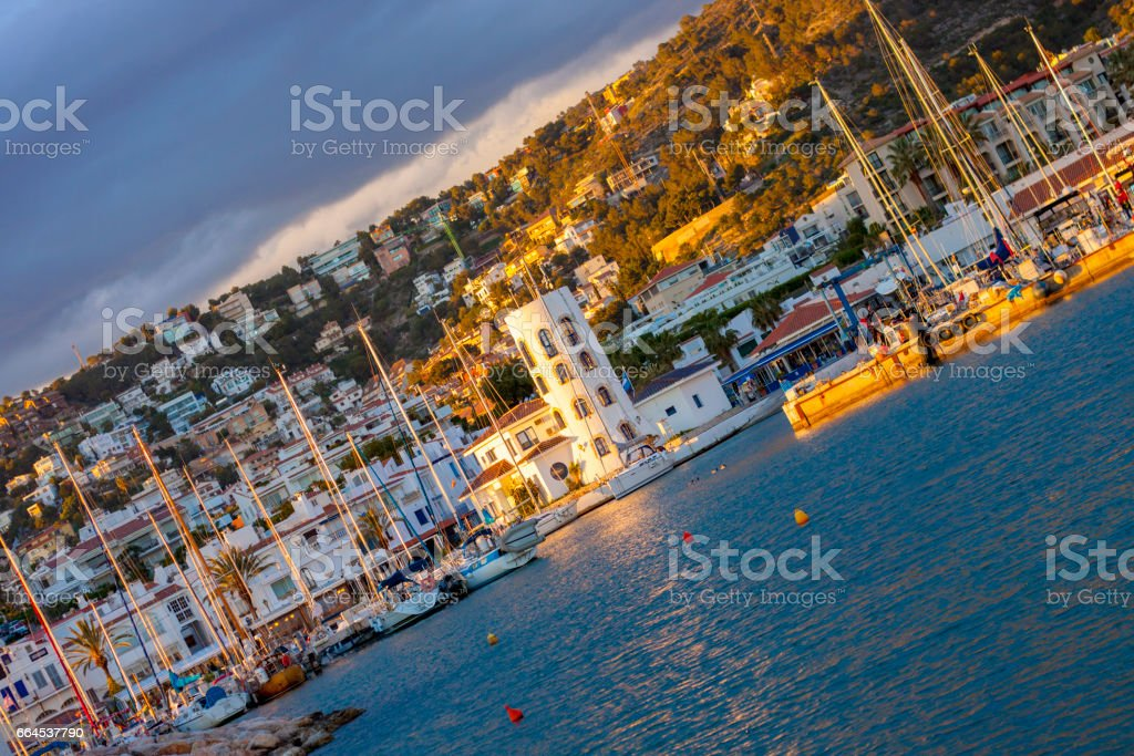 Sitges Port during sunset stock photo