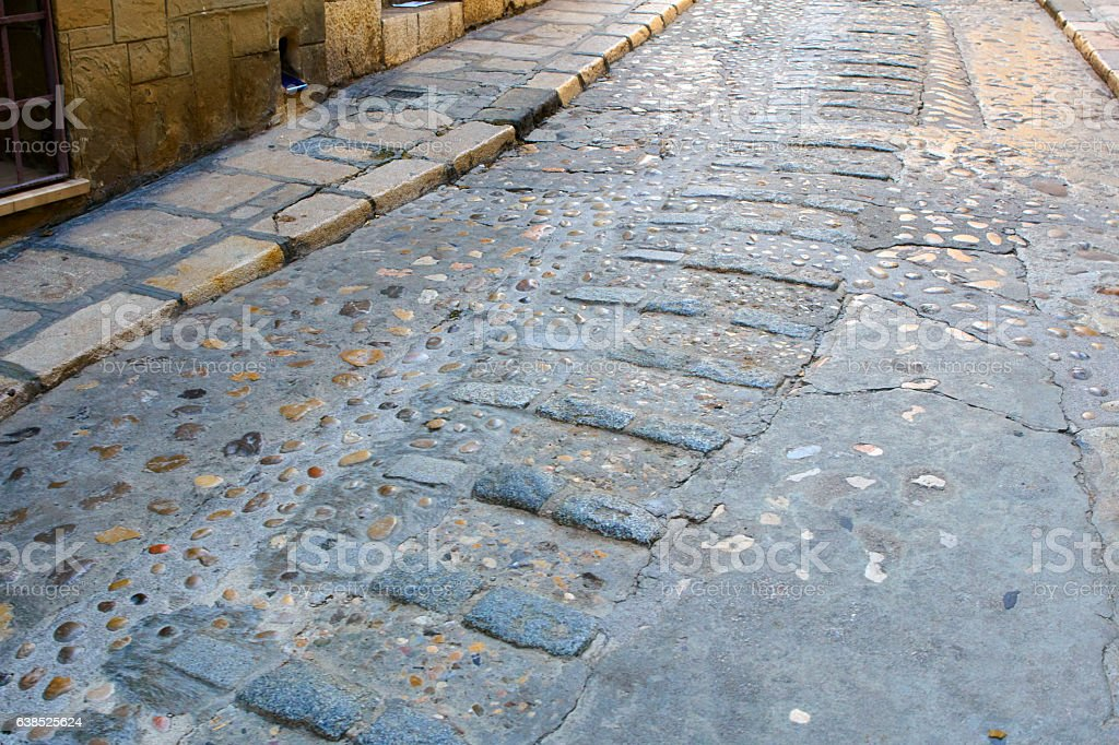 Sitges street with roman pavement stock photo