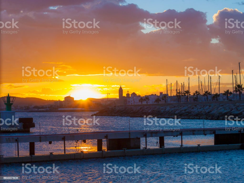 Sitges sunset from the port stock photo