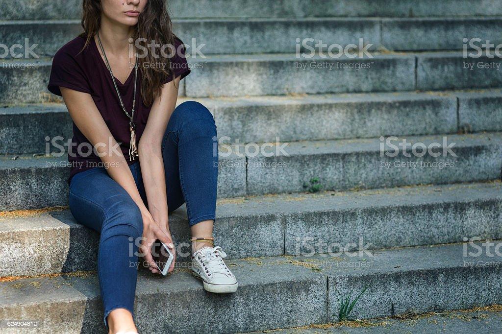 Sitting alone stock photo