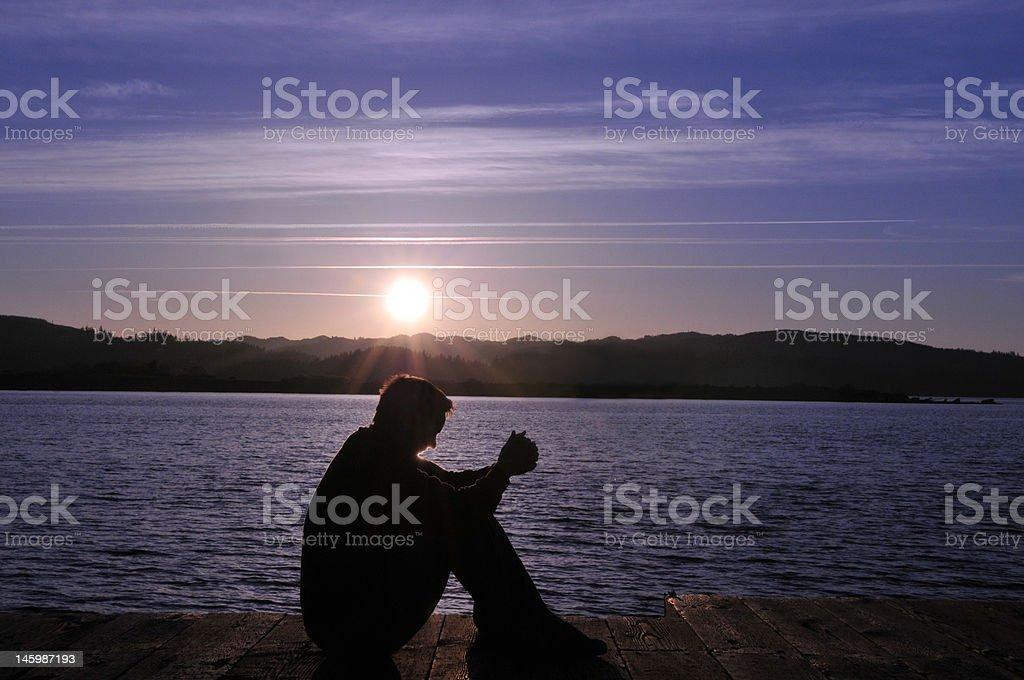 Sitting and Praying royalty-free stock photo