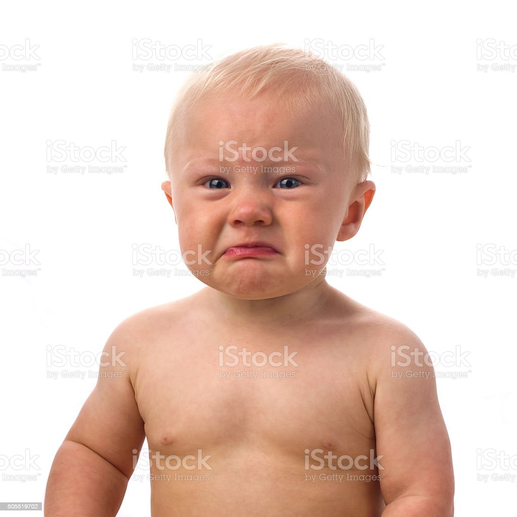 sitting angry 8 month boy stock photo