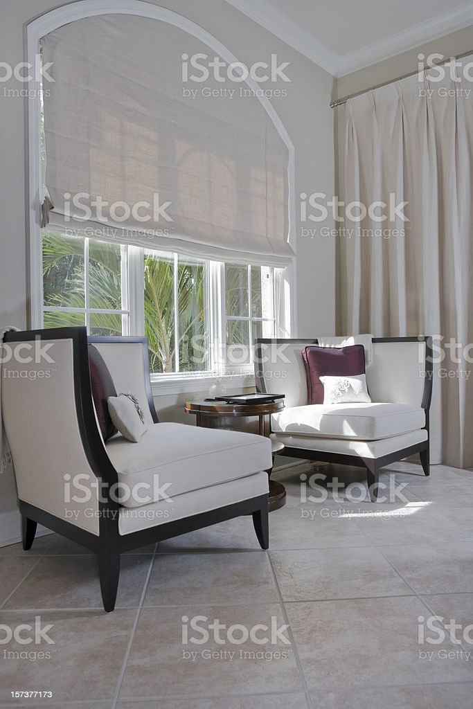 Sitting Area Featuring Custom Designed Chairs by a Window royalty-free stock photo