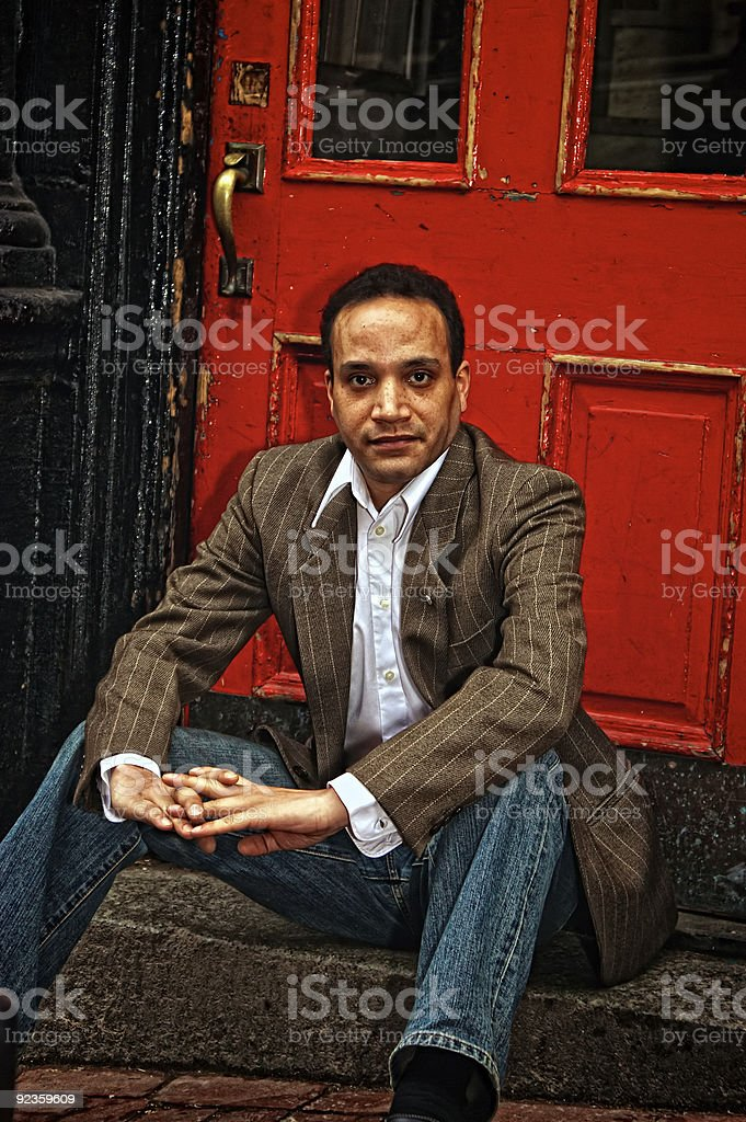 sitting at red door royalty-free stock photo