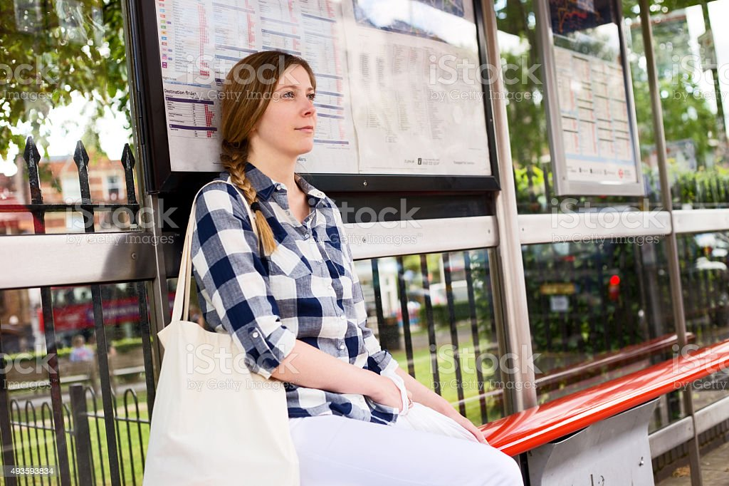 sitting at the bus stop royalty-free stock photo
