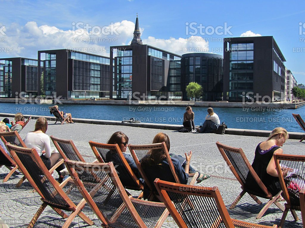 Sitting at the Copenhagen waterfront stock photo
