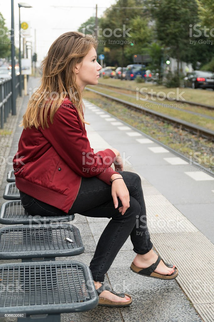 Sitting at the tram station in Berlin stock photo