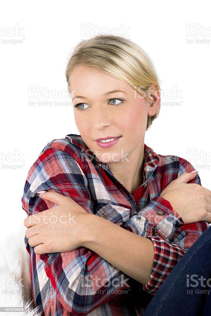 sitting bretty blonde in red lumberjack shirt portrait stock photo