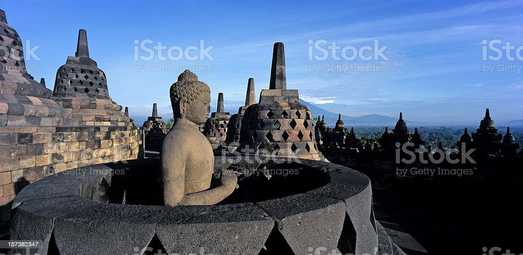 Sitting buddha inside a stupa at the borobudur temple stock photo