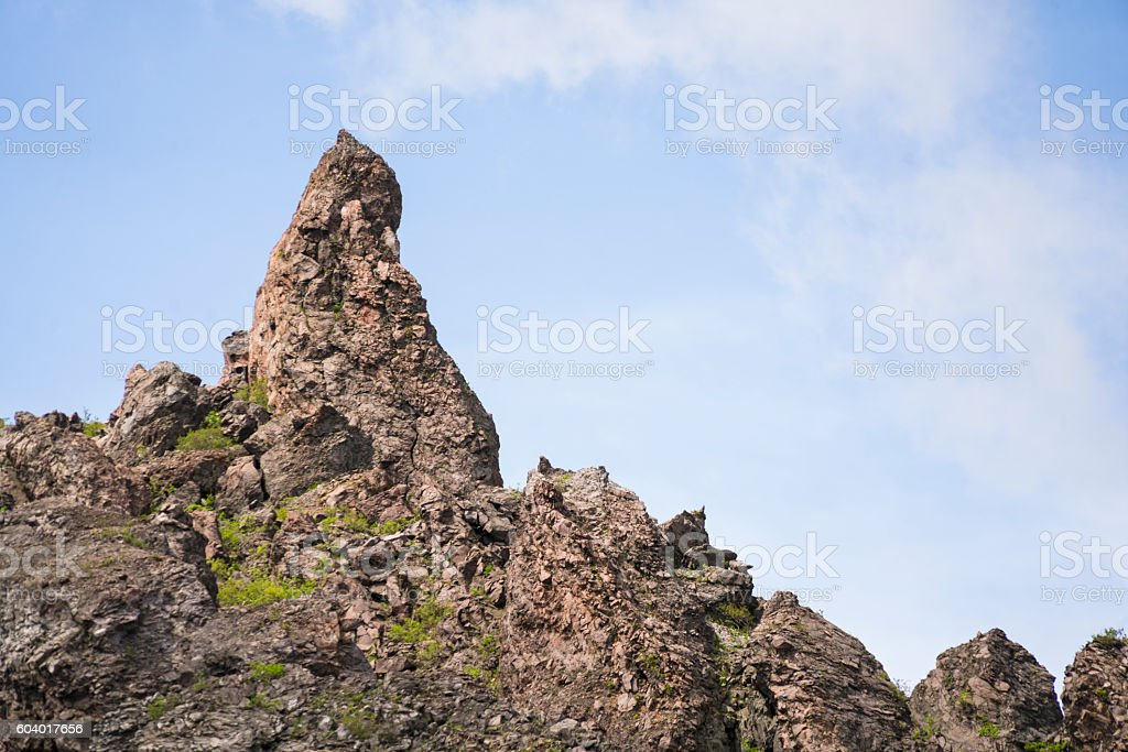 Sitting Buddha rock on Hokkaidos active volcano Mount Usu, Japan stock photo