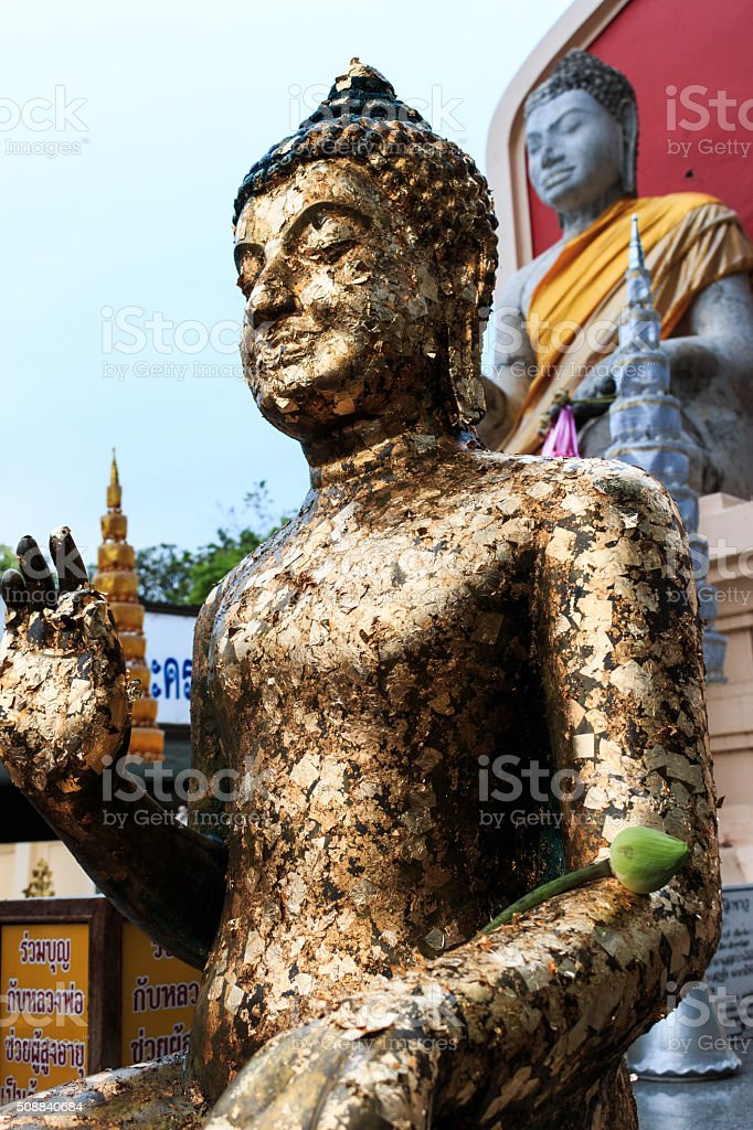 Sitting Buddha statue in Thai Buddhist stock photo