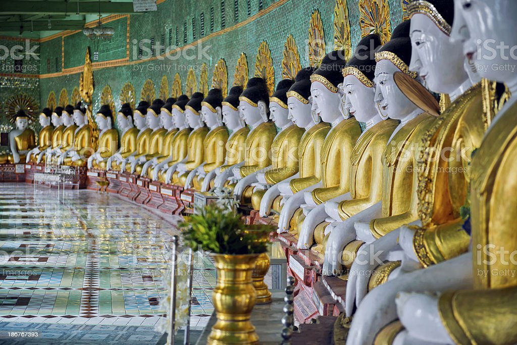Sitting Buddhas at the Umin Thonze Temple royalty-free stock photo