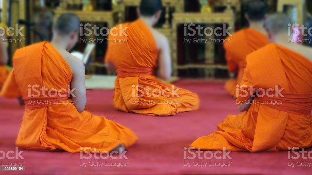 Sitting Buddhist Monks Praying To Buddha At A Temple.Bangkok.Thailand stock photo
