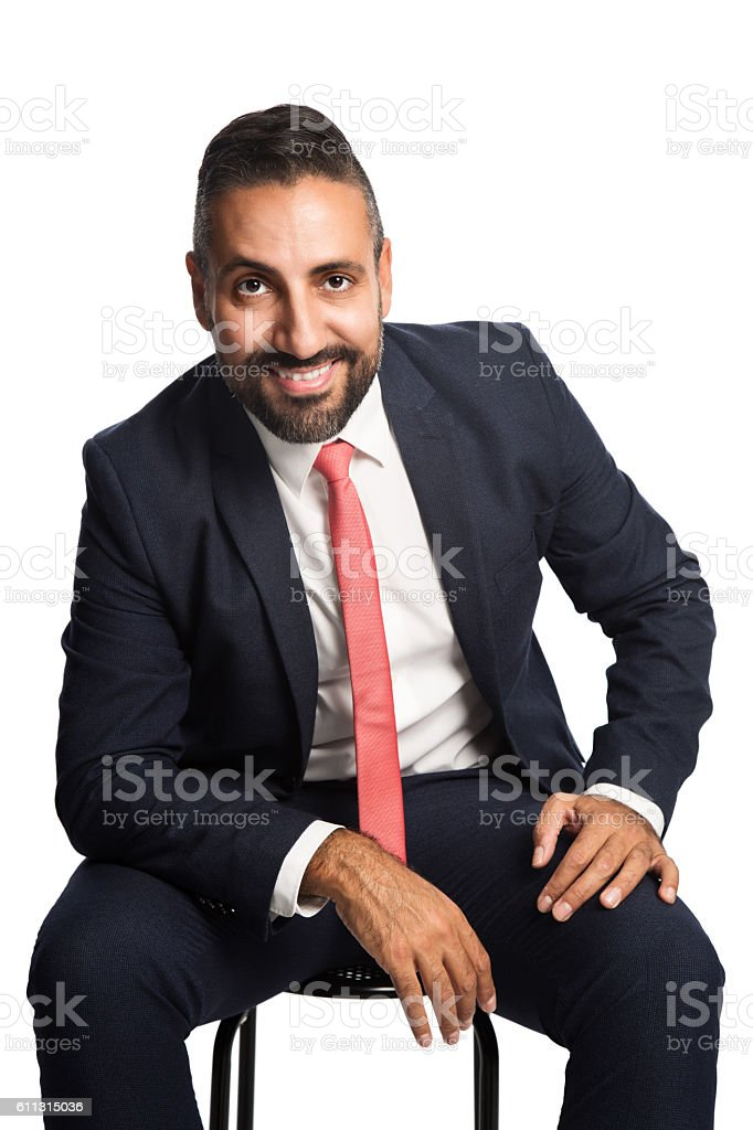 Sitting businessman smiling stock photo