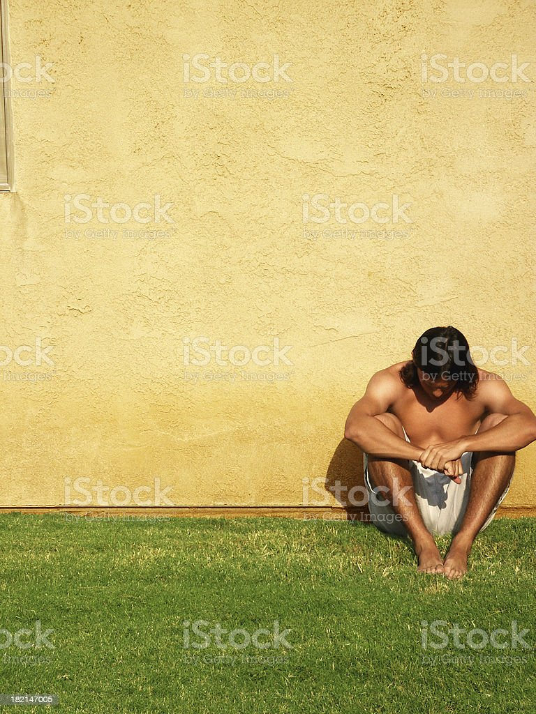 Sitting by the Wall royalty-free stock photo