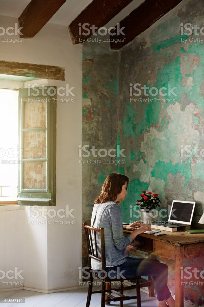 Sitting down to work on her blog stock photo