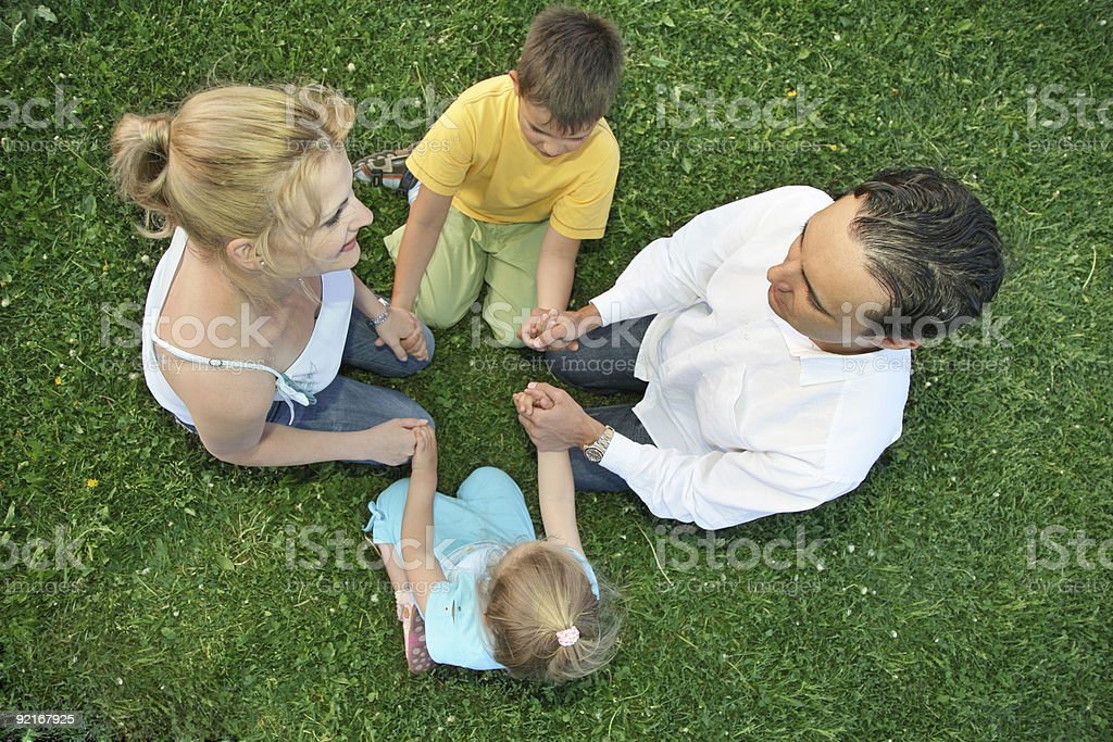 sitting family grass royalty-free stock photo