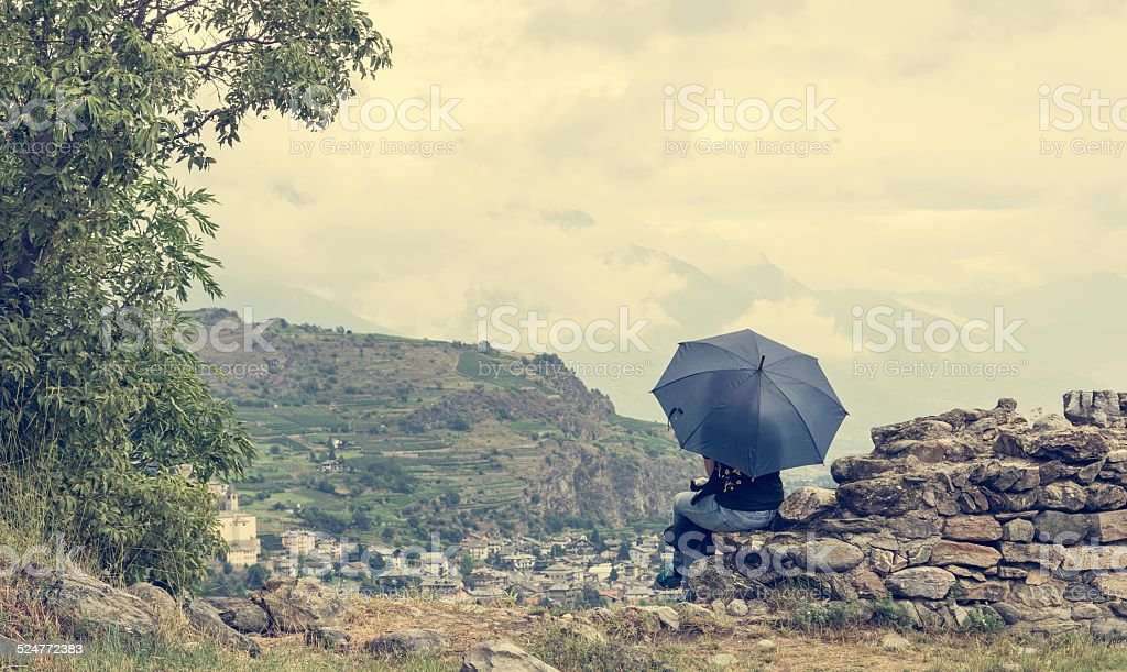 Sitting girl holding an umbrella stock photo