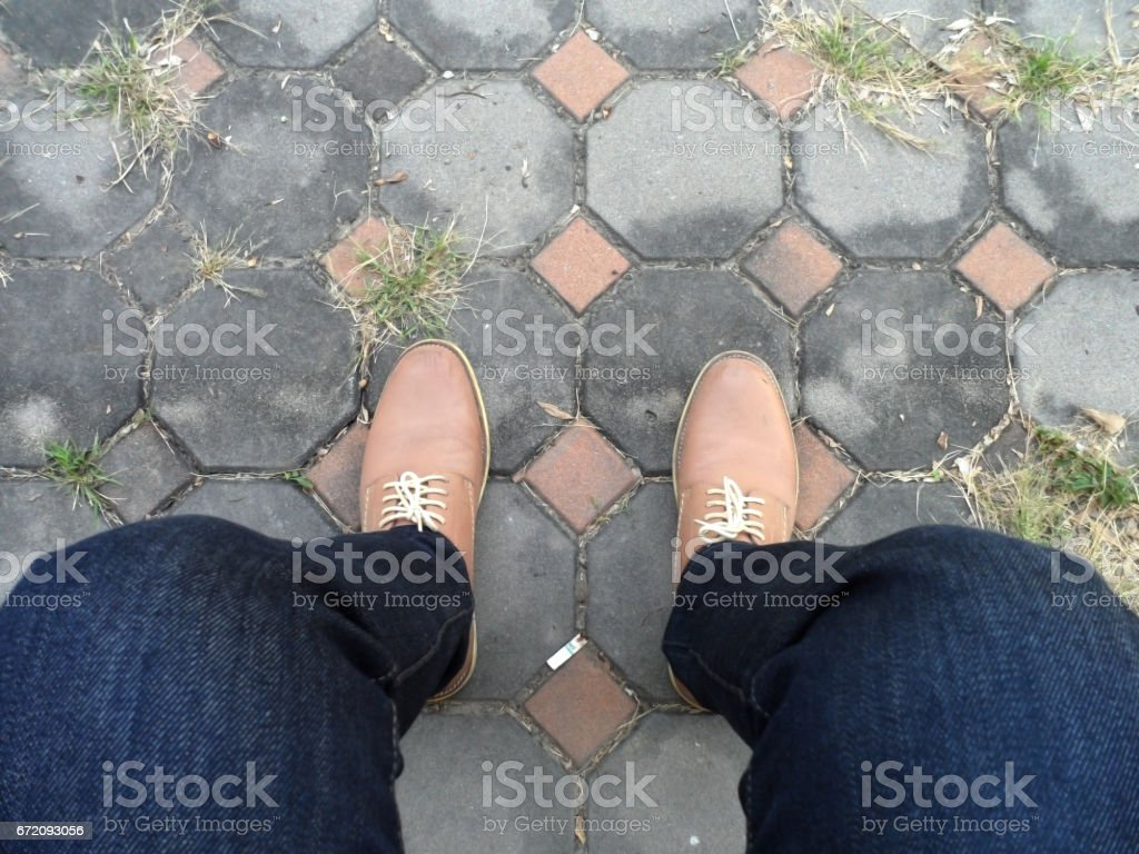 Sitting hipster guy with old elegant shoes stock photo