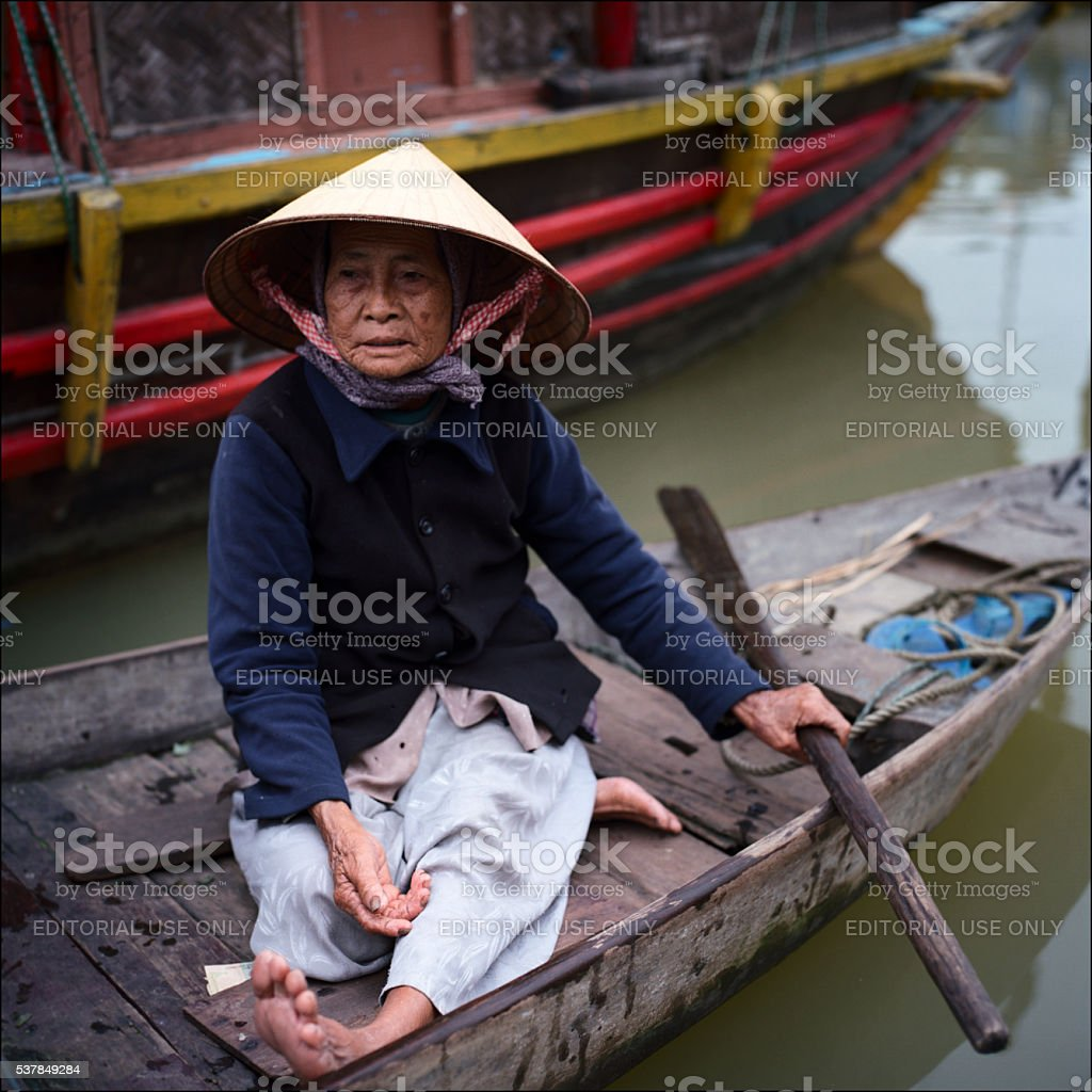 Sitting in a boat stock photo
