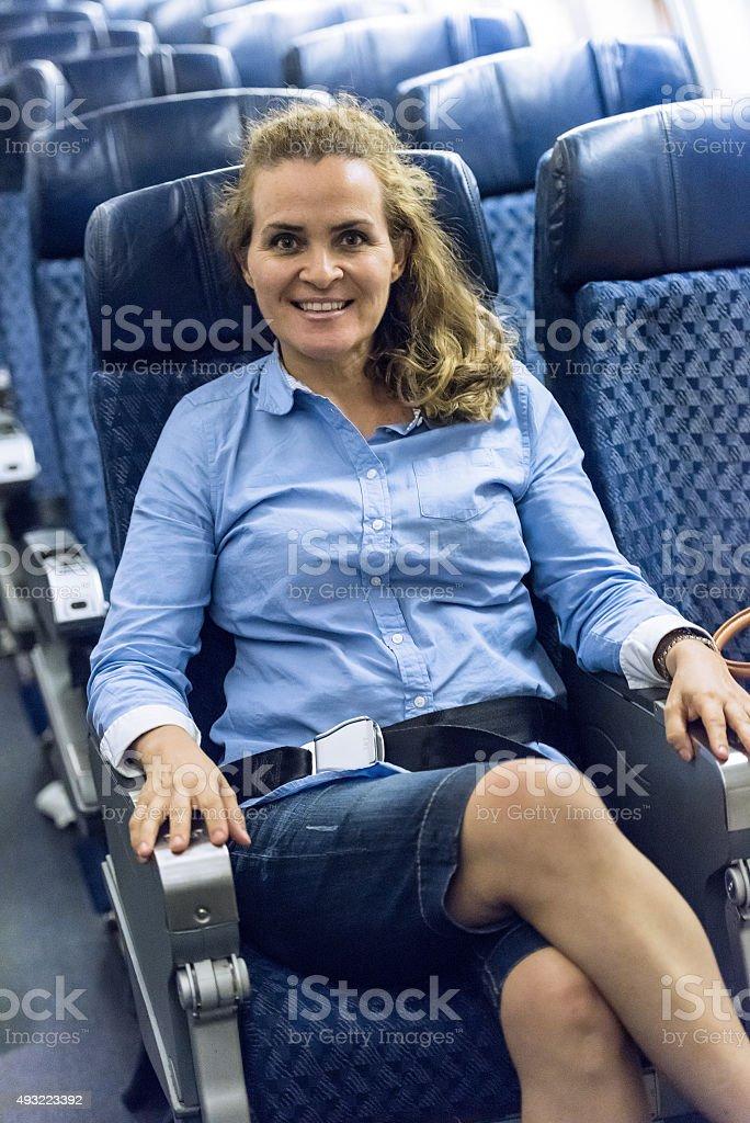 Sitting in economy class stock photo