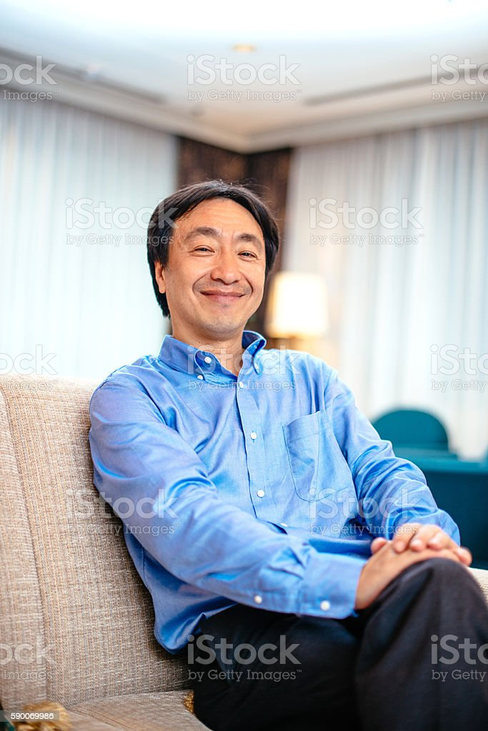 CEO sitting in his cabinet and smiling stock photo
