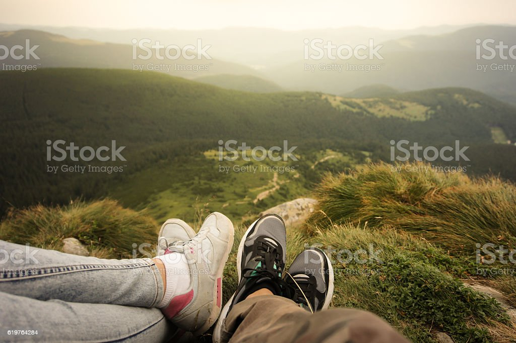 Sitting in mountains stock photo