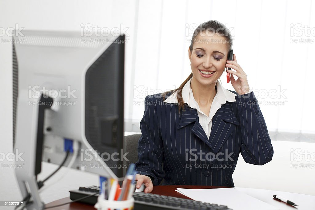 Sitting in office and calling royalty-free stock photo