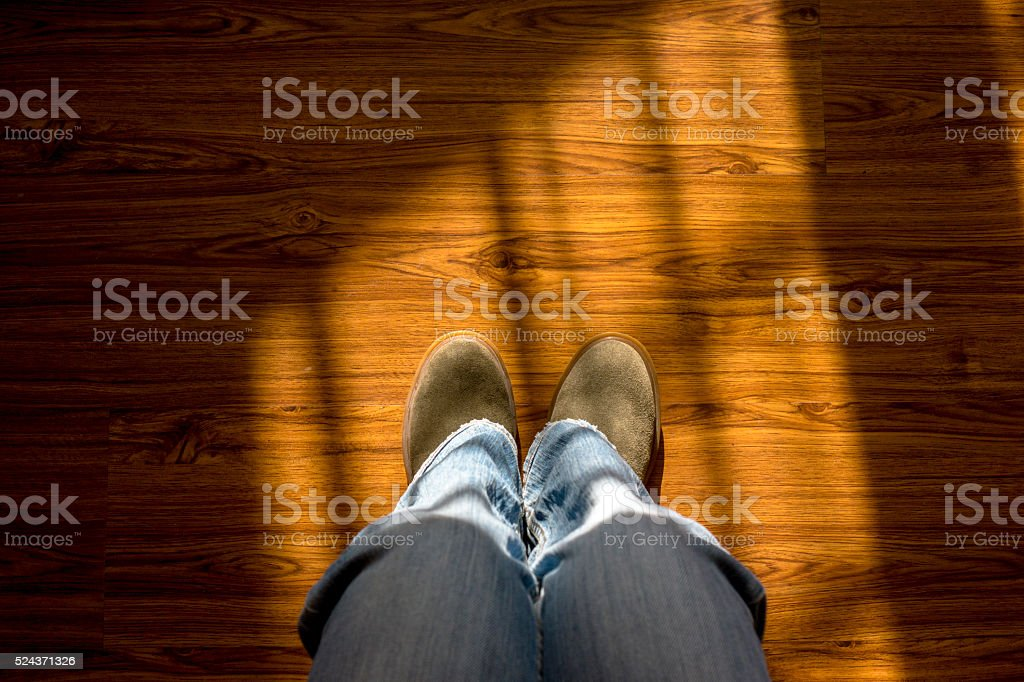 sitting in sunlight, looking down from knee stock photo