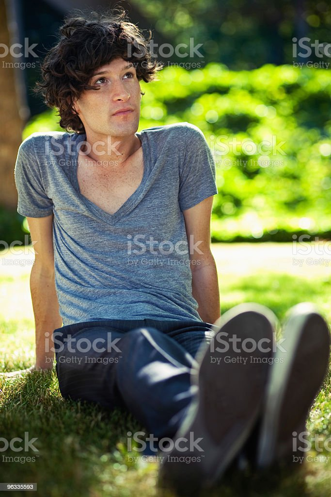 Sitting in the Grass stock photo
