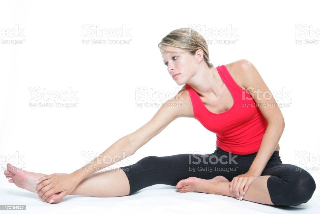 Sitting leg stretch stock photo