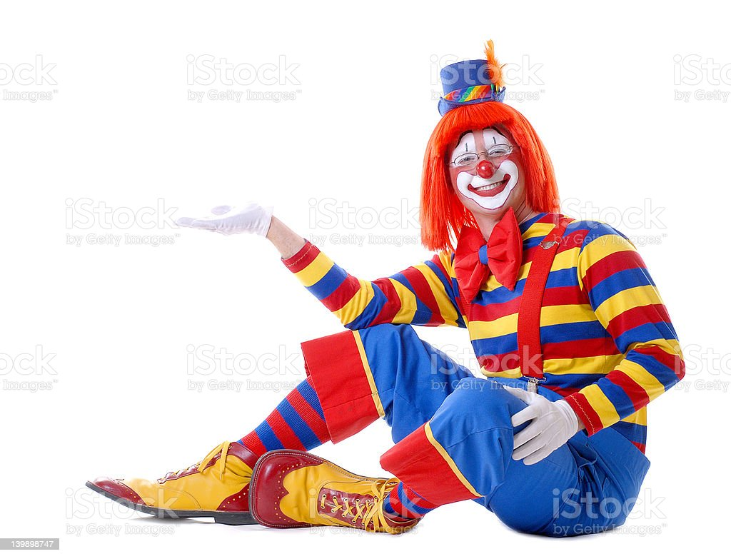 Sitting Male Clown Holding Out His Hand stock photo