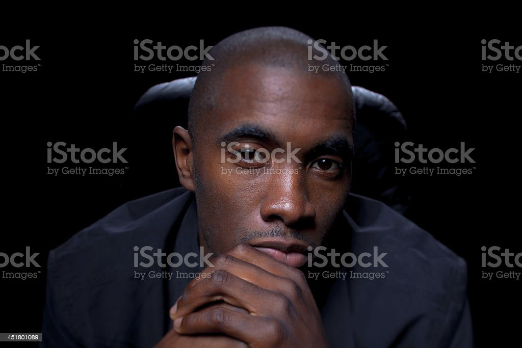 Sitting Man with Clasped Hands royalty-free stock photo