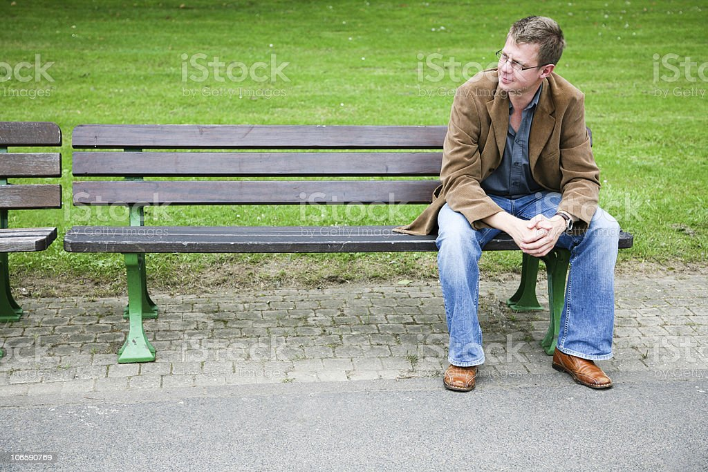 sitting on a park bench royalty-free stock photo