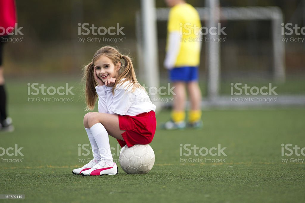 Sitting on a soccer ball stock photo