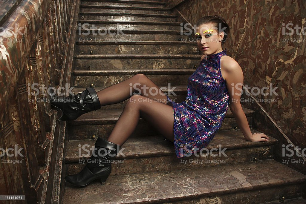 Sitting on a staircase stock photo