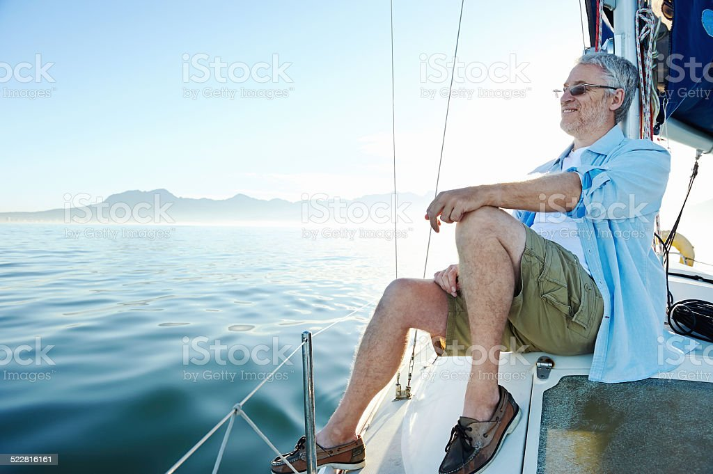 sitting on boat man stock photo