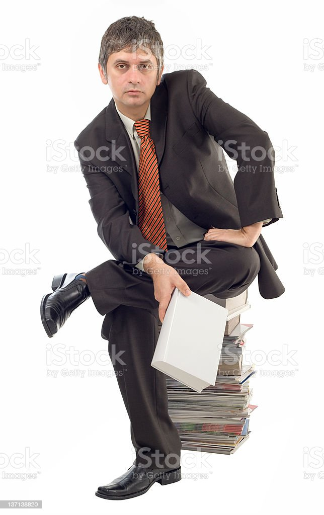 Sitting on book pile royalty-free stock photo