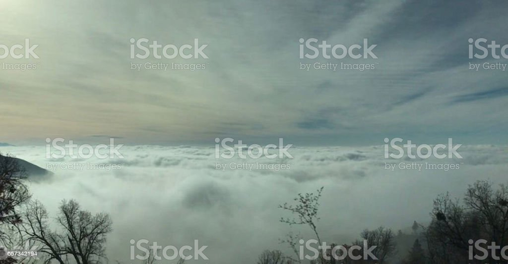 Sitting on Clouds stock photo