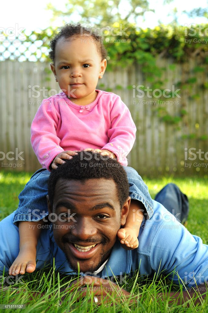 Sitting on Daddy royalty-free stock photo