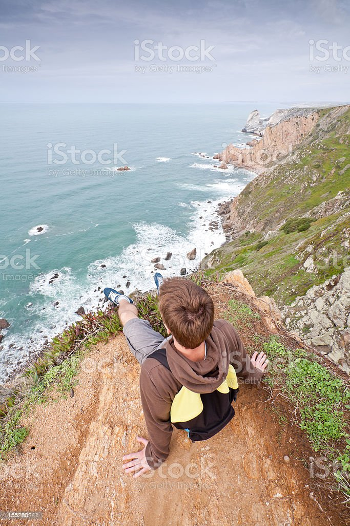 Sitting on edge of the cliff royalty-free stock photo