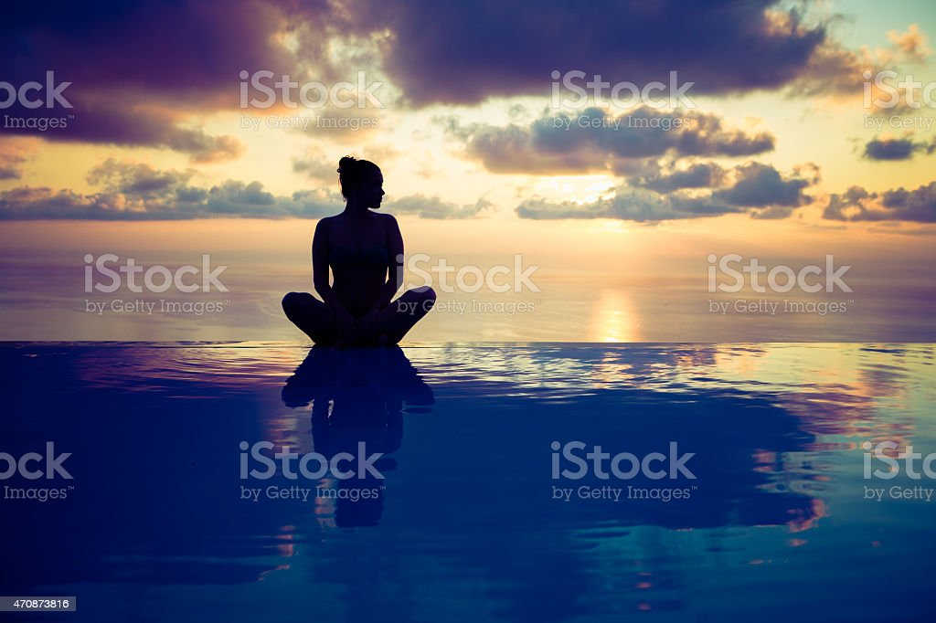Sitting on edge of the pool stock photo