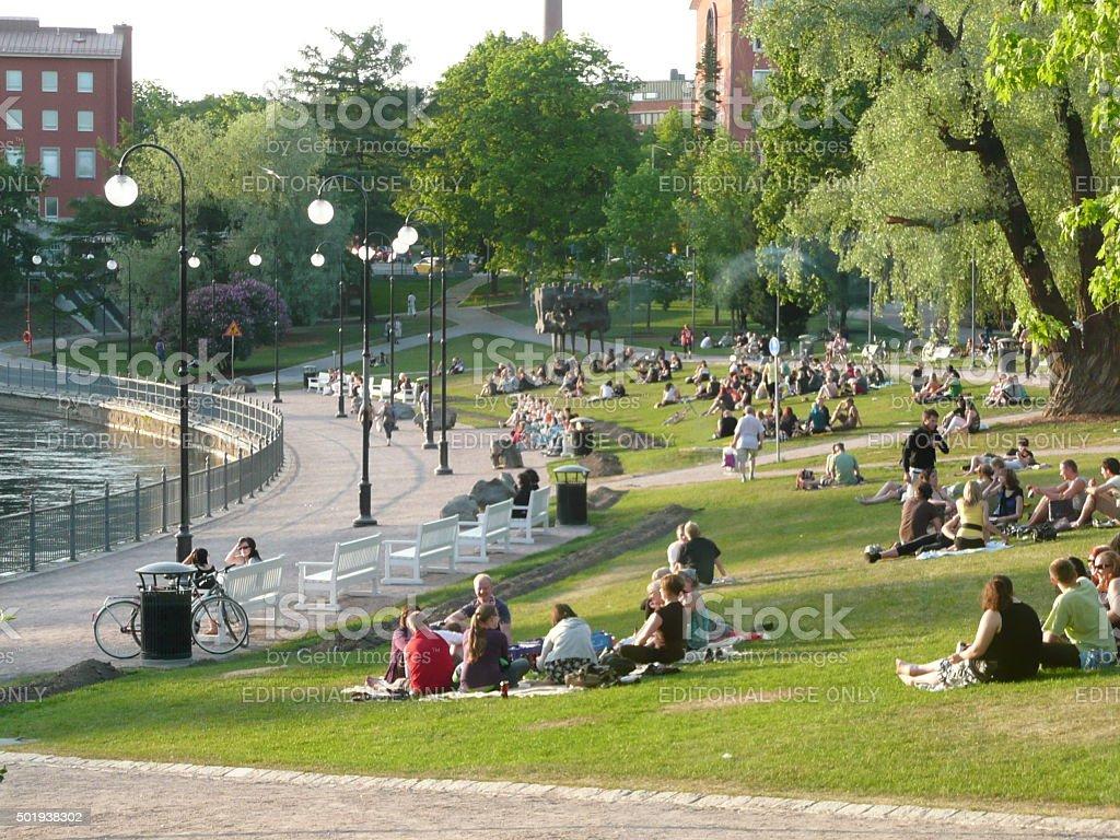 Sitting on grass, Finland stock photo