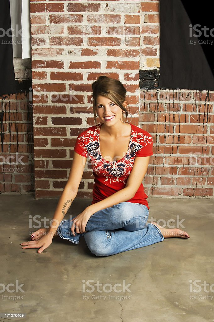 Sitting on ground stock photo